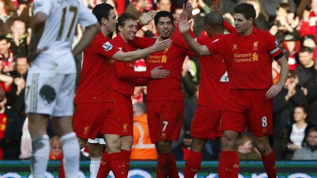 Liverpool&#39;s Luis Suarez (C) celebrates his goal against Swansea City with team mates (Reuters)