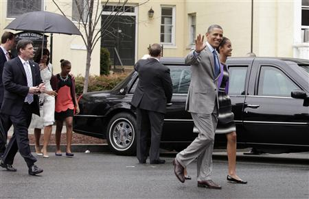 U.S. President Barack Obama waves as he walks with first lady Michelle Obama (L) and their daughters Malia (R) and Sasha after attending Easter service at St. John's Episcopal Church in Washington March 31, 2013. REUTERS/Yuri Gripas