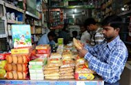 An Indian man shops in New Delhi in 2011. India&#39;s consumer spending is at its weakest in seven years, global ratings agency Fitch said on Tuesday, as it cut the outlook for India&#39;s vast retail sector from stable to negative