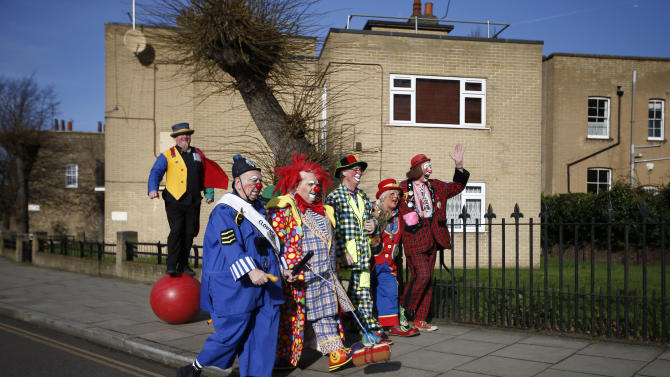 Clowns arrive at the All Saints Church before the Grimaldi clown service in Dalston, north London