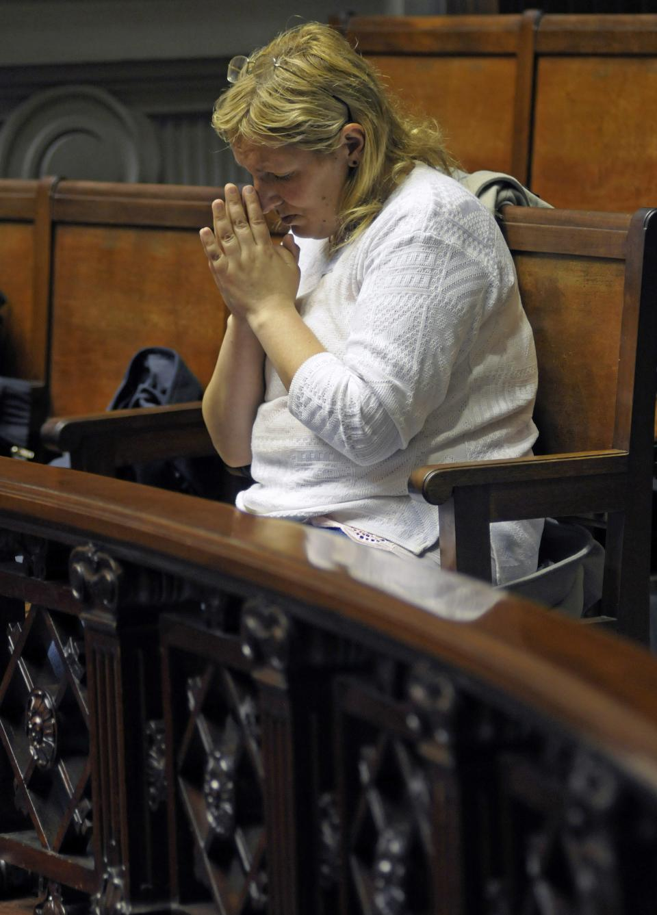 A pro-life activist prays in the senate gallery as lawmakers discuss an abortion bill in Montevideo, Uruguay, Wednesday, Oct. 17, 2012.  The Uruguayan Senate on Wednesday voted to legalize all first trimester abortions in a groundbreaking step in Latin America. (AP Photo/Matilde Campodonico)