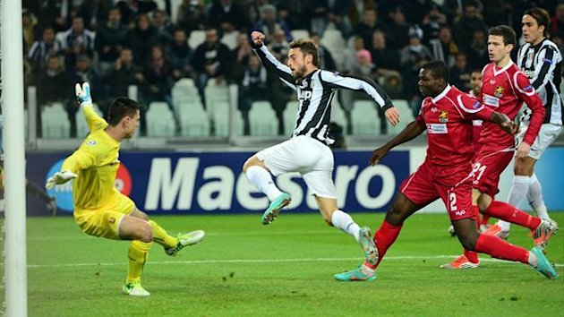 Juventus' midfielder Claudio Marchisio scores during the Champions League match between Juventus and FC Nordsjaelland