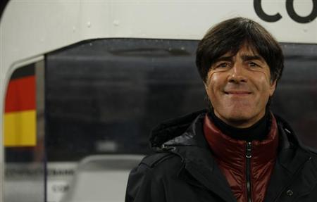 Germany's coach Joachim Loew smiles before their 2014 World Cup qualifying soccer match against Ireland in Cologne October 11, 2013. REUTERS/Ina Fassbender