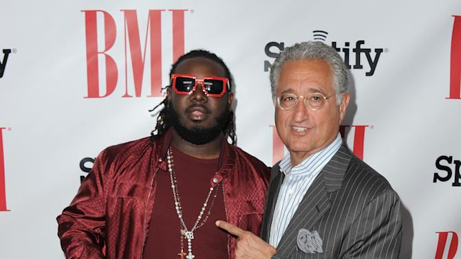 T-Pain and Del Bryant, BMI President & CEO arrive at the BMI Urban Awards on Friday, Sept. 7, 2012 in Beverly Hills, Calif. (Photo by Jordan Strauss/Invision/AP)