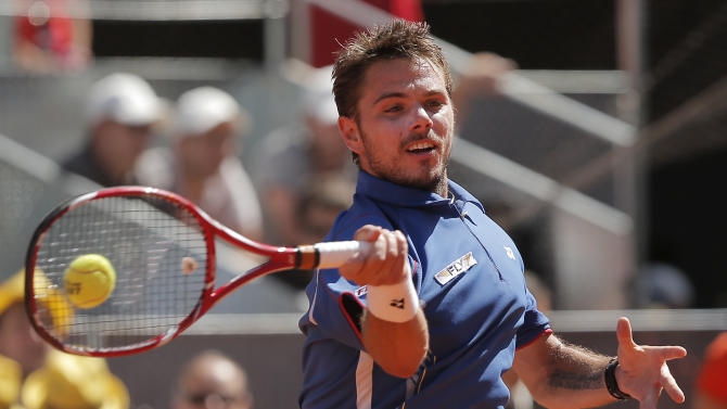 Stanislas Wawrinka from Switzerland returns the ball to Rafael Nadal from Spain during the men's final match at the Madrid Open tennis tournament, in Madrid, Sunday, May 12, 2013. (AP Photo/Andres Kudacki)