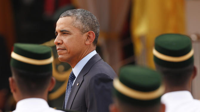 U.S. President Barack Obama, left, walks out from a welcome ceremony at Parliament Square in Kuala Lumpur, Malaysia, Saturday, April 26, 2014. (AP Photo/Vincent Thian)