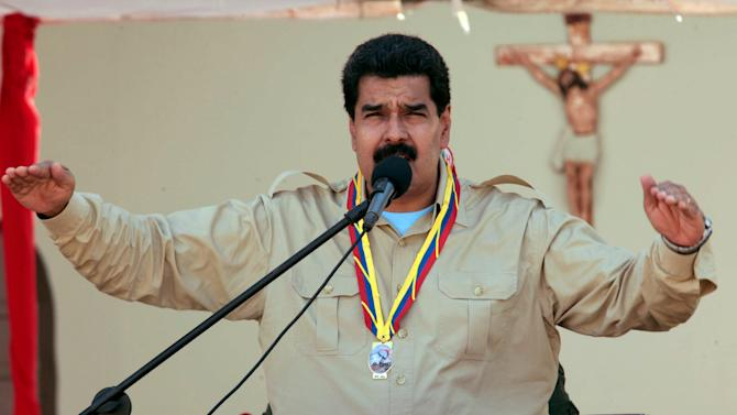 In this photo released by Miraflores Press Office, Venezuela's Nicolas Maduro speaks to soldiers inside a military base in Coro, Venezuela, Monday, Sept. 30, 2013. Maduro said Monday that his government was expelling the top U.S. diplomat in Venezuela and two other embassy employees for allegedly conspiring with the political opposition. (AP Photo/Miraflores Press Office)