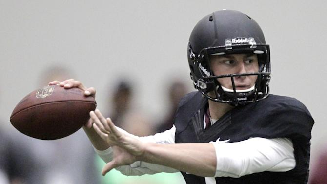 Texas A&M quarterback Johnny Manziel passes the ball during a drill at pro day for NFL football representativesin College Station, Texas, Thursday, March 27, 2014