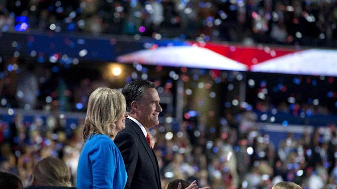 Republican presidential candidate, former Massachusetts Gov. Mitt Romney stands with his wife Ann, after delivering a speech to the Republican National Convention on Thursday, Aug. 30, 2012 in Tampa, Fla.  (AP Photo/Evan Vucci)