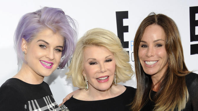 "FILE - In this April 30, 2012 file photo, Kelly Osbourne, left, and Joan Rivers, center, co-hosts of the show ""Fashion Police"" and show producer Melissa Rivers pose at an E! Network upfront event in New York. In a statement Friday, Sept. 19,  E! TV channel says that ""Fashion Police"" will continue without Joan Rivers.  Rivers, 81, died Sept. 4, 2014 after going into cardiac arrest at a doctor's office on Aug. 28. (AP Photo/Evan Agostini, File)"