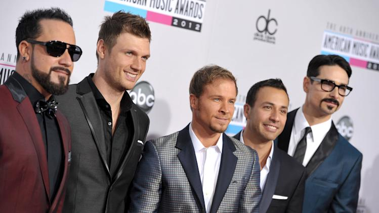 The Backstreet Boys, from left, A.J. McLean, Nick Carter, Brian Littrell, Howie Dorough, and Kevin Richardson arrive at the 40th Anniversary American Music Awards on Sunday, Nov. 18, 2012, in Los Angeles. (Photo by John Shearer/Invision/AP)