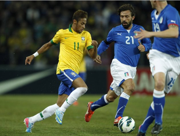 Italy's Pirlo fights for the ball with Brazil's Neymar during their international friendly soccer match at the Stade de Geneve in Geneva