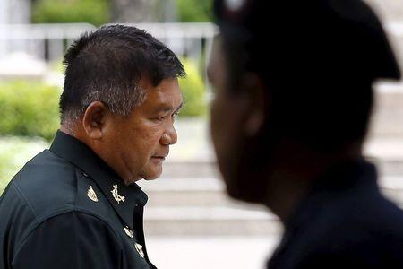 Lieutenant General Manus Kongpan arrives at National Police Headquarters as he turns himself in to authorities in Bangkok