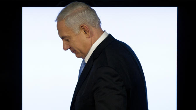 Israeli Prime Minister Benjamin Netanyahu leaves after a press conference in Jerusalem, Tuesday, April 3, 2012. Netanyahu said that the planned evacuation of a group of Jewish settlers who illegally occupied a West Bank house has been put on hold. (AP Photo/Bernat Armangue)