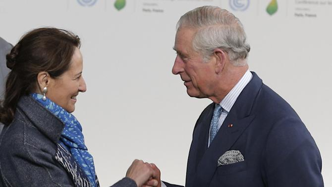 Britain's Prince Charles, right, is greeted by Segolene Royal, French Minister for Ecology, Sustainable Development and Energy, left, as he arrives for the COP21, United Nations Climate Change Conference, in Le Bourget, outside Paris, Monday, Nov. 30, 2015. (AP Photo/Christophe Ena, Pool)