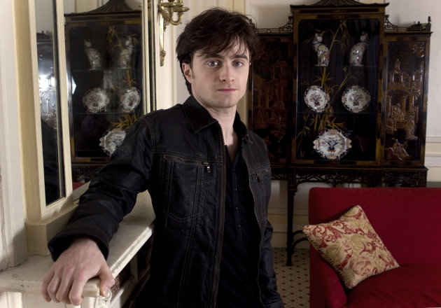 FILE - In this Nov. 12, 2010 file photo, British actor Daniel Radcliffe poses for photographs following an interview with the Associated Press to discuss his role in Harry Potter and the Deathly Hallows Part 1. The time is coming - maybe sooner than you expect - when you look at Daniel Radcliffe and don&#39;t think &quot;Harry Potter.&quot; The 23-year-old actor has gone from boy wizard to Broadway hoofer to Beat poet Allen Ginsberg, whom he plays in new film Kill Your Darlings. (AP Photo/Joel Ryan, File)
