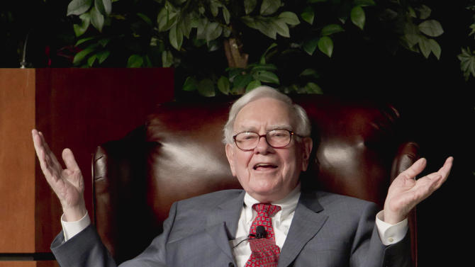 Billionaire investor Warren Buffett speaks in Omaha, Neb., Monday, Nov. 14, 2011 at an event to raise money for the Girls Inc., charity organization. Buffett, Chairman and CEO of Berkshire Hathaway, said his company bought about $10.7 billion of IBM stock this year, giving him a stake of more than 5 percent stake in the technology company. (AP Photo/Nati Harnik)
