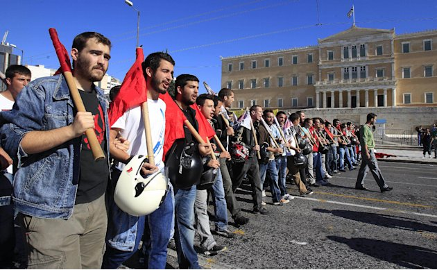 Protesters shout slogans in front of the Parliament in Athens on Tuesday Nov. 6, 2012. Greece's unions are holding their third general strike in six weeks to press dissenters in the country's troubled