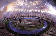 Fireworks explode over the stadium at the end of the Opening Ceremony of the 2012 Olympic Summer Games at the Olympic Stadium in London, Saturday, July 28, 2012. (AP Photo/ Ezra Shaw, Pool)