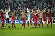 Bayern Munich's players celebrate after their UEFA Champions League 2nd leg quarter-final match vs Olympique de Marseille, in Munich, southern Germany, on April 3. Having reached the Champions League semis, Bayern turn their attention back to the German league and resurgent Augsburg as they look to attack Borussia Dortmund's three-point lead