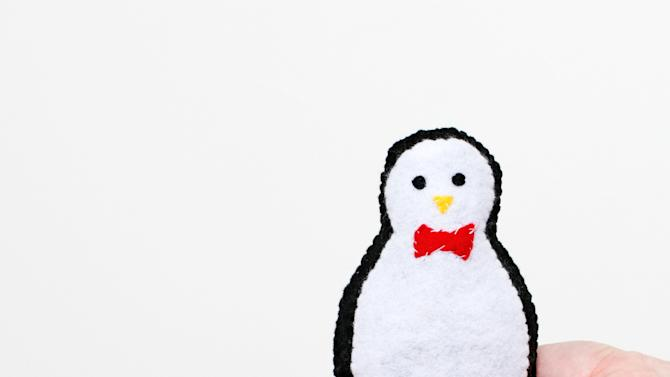 "This undated publicity photo provided by Quirk Books shows Sarah Goldschadt's Plush Penguin made of felt, whose template can be used to make several paper crafts. The holiday doldrums are just the thing for unleashing children's creativity. If they can wield a pair of scissors, kids can make the cute characters in Goldschadt's book, ""Craft-A-Day"" (Quirk Books, 2012). (AP Photo/Quirk Books, Sarah Goldschadt)"