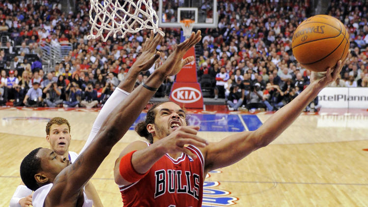 Chicago Bulls center Joakim Noah, right, shoots while defended by Los Angeles Clippers center DeAndre Jordan during the first half of their NBA basketball game, Friday, Dec. 30, 2011, in Los Angeles. (AP Photo/Mark J. Terrill)