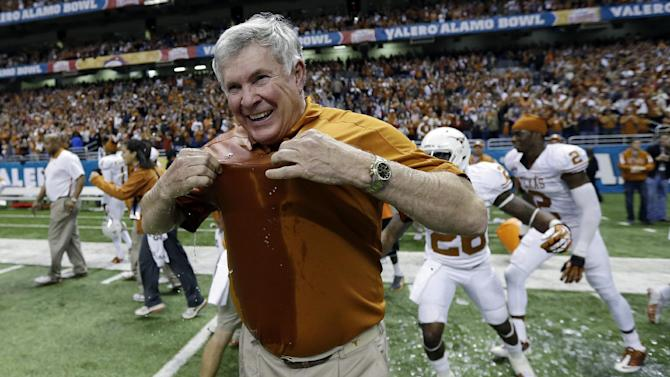 Texas head coach Mack Brown reacts after he was doused following the Longhorns win over Oregon State in the Alamo Bowl NCAA football game, Saturday, Dec. 29, 2012, in San Antonio.  Texas won 31-27. (AP Photo/Eric Gay)