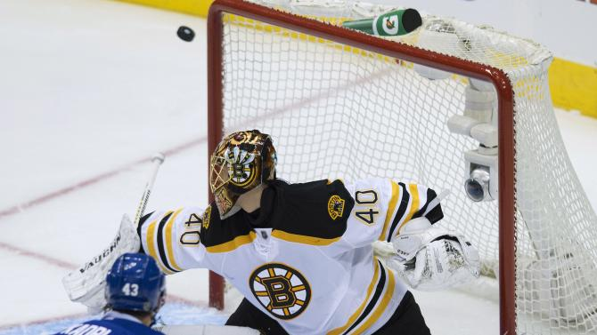 Toronto Maple Leafs forward Nazem Kadri, left, misses the net past Boston Bruins goalie Tuuka Rask, right, during second period NHL hockey playoff action in Toronto on Sunday, May 12, 2013. (AP Photo/The Canadian Press, Nathan Denette)
