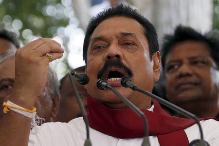 Former Sri Lankan president Mahinda Rajapaksa speaks to his supporters at his residence in Medamulana