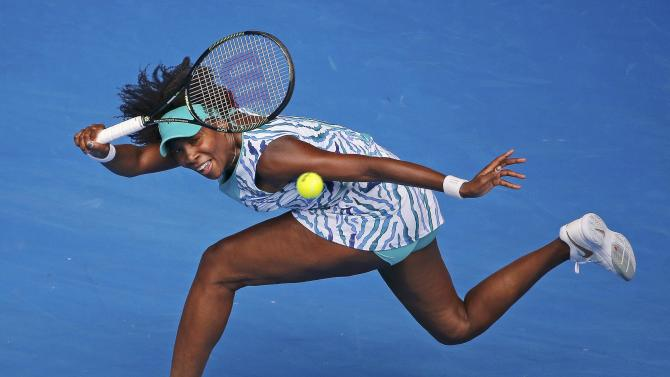 Venus of the U.S. hits a return to compatriot Keys during their women's singles quarter-final match at the Australian Open 2015 tennis tournament in Melbourne