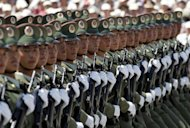 "<p>Chinese soldiers take part in a 2004 parade to mark the establishment of new miltary barracks. China has warned that American criticism of its decision to set up a new military garrison in the South China Sea sent the ""wrong signal"" and threatened peace in the hotly disputed waters.</p>"