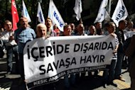 Turks hold a banner that reads &quot;no to war&quot; during a protest in Ankara. The Turkish parliament authorised further military action against Syria but Prime Minister Recep Tayyip Erdogan said he was not looking for a mandate for war, although he warned there would be &quot;a big price&quot; to pay for any further attacks on its citizens or territory