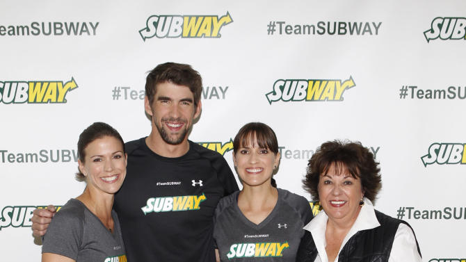 From left, Whitney Phelps is joined by her bother, Olympic swimming champion Michael Phelps, sister Hilary and mother Debbie as as she announces that she will run the ING New York City Marathon with Team SUBWAY at the Chelsea Piers Sport Center, Monday, Oct. 15, 2012 in New York. (Photo by Jason DeCrow/Invision for SUBWAY/AP Images)