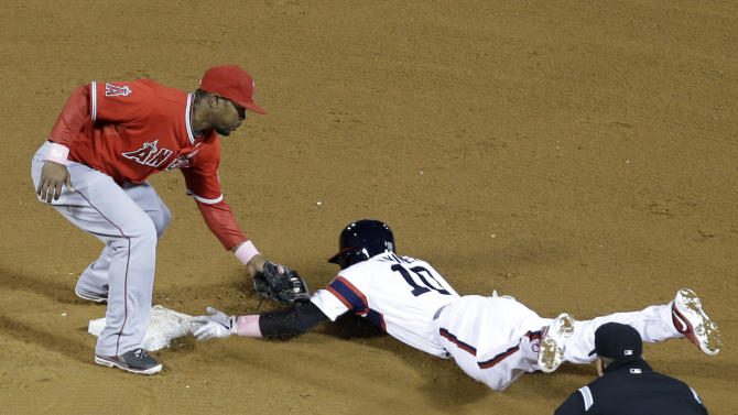 Chicago White Sox's Alexei Ramirez, right, steals second base as Los Angeles Angels second baseman Howie Kendrick applies a late tag during the sixth inning of a baseball game in Chicago, Sunday, May 12, 2013. (AP Photo/Nam Y. Huh)
