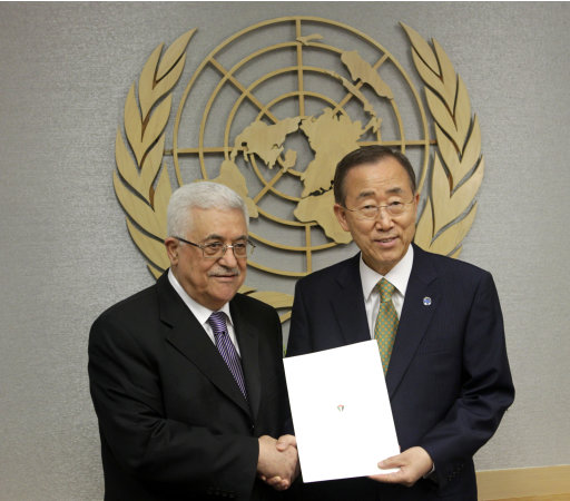 Palestinian President Mahmoud Abbas, left, poses for a picture with Secretary-General Ban Ki-moon after giving him a letter requesting recognition of Palestine as a state during the 66th session of the General Assembly at United Nations headquarters Friday, Sept. 23, 2011. (AP Photo/Seth Wenig)