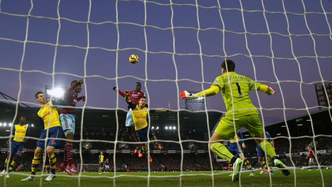 West Ham United's Kouyate heads and scores a goal during their English Premier League match against Arsenal in London