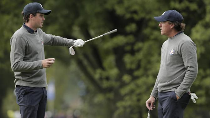 USA's Keegan Bradley talks to Phil Mickelson at the Ryder Cup PGA golf tournament Tuesday, Sept. 25, 2012, at the Medinah Country Club in Medinah, Ill. (AP Photo/Charlie Riedel)
