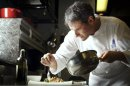Chef Pino Lavarra works in the kitchen at Tosca inside Ritz-Carlton in Hong Kong