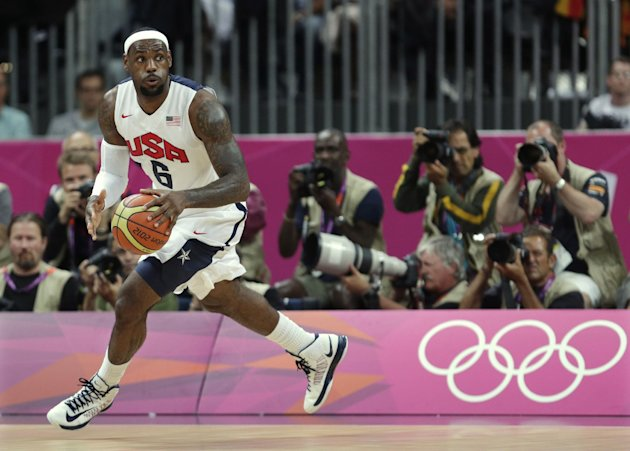 United States&#39; Lebron James looks up the court during the first half of a preliminary men&#39;s basketball game against France at the 2012 Summer Olympics, Sunday, July 29, 2012, in London. (AP Photo/Charles Krupa)