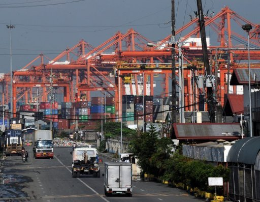 <p>Cranes and container trucks are seen at the port of Manila on August 30. The Philippines said Thursday the economy grew a better-than-forecast 5.9 percent in the three months to June, largely due to a strong services sector.</p>