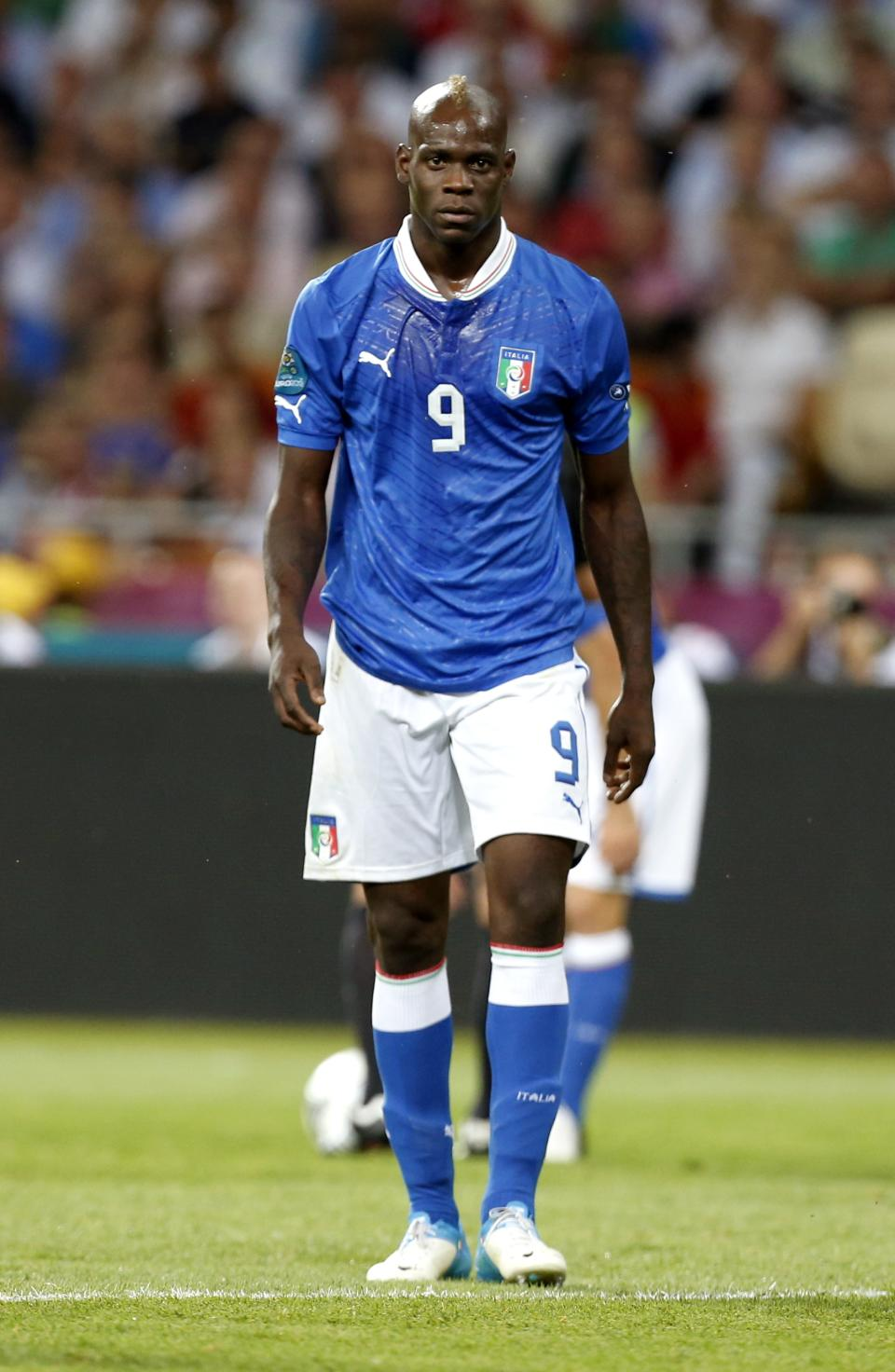 Italy's Mario Balotelli walks on the pitch during the Euro 2012 soccer championship final  between Spain and Italy in Kiev, Ukraine, Sunday, July 1, 2012. (AP Photo/Jon Super)
