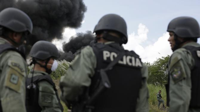 Police officers stand guard during the incineration of confiscated drugs in Panama City