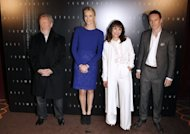 L-R: British film director Sir Ridley Scott, flanked by South African actress Charlize Theron, Swedish actress Noomi Rapace and Irish-German actor Michael Fassbender, poses during a photocall for the premiere of his movie &quot;Prometheus&quot; in Paris. Scott&#39;s new project follows a space mission in search of an alien civilisation believed to hold the key to the origins of mankind