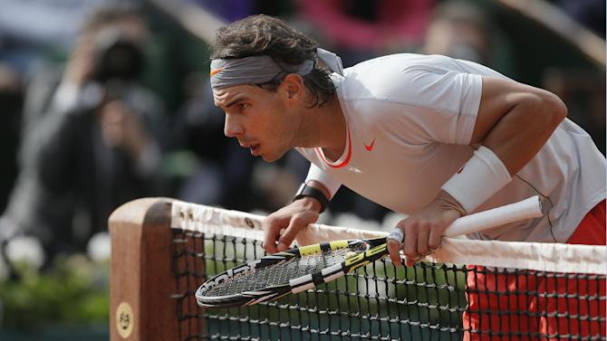 Spain's Rafael Nadal checks the mark of a ball on the court in his third round match against Italy's Fabio Fognini at the French Open tennis tournament, at Roland Garros stadium in Paris, Saturday, June 1, 2013. (AP Photo/Michel Spingler)