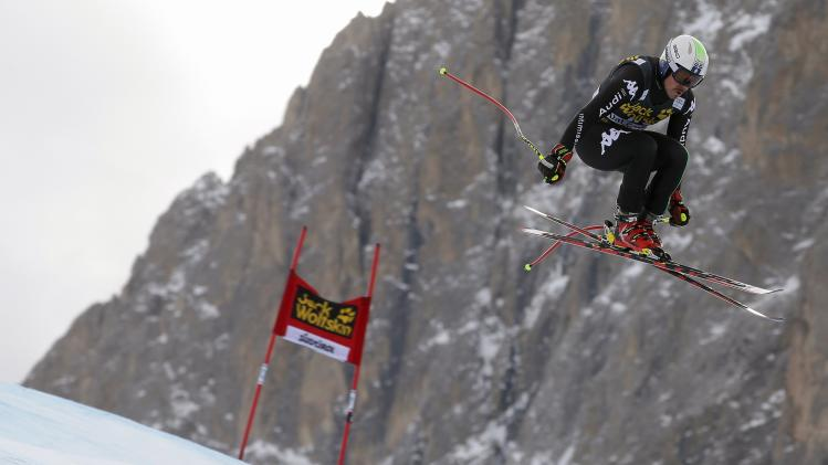 Italy's Fill clears a gate during the second training session of the Men's World Cup Downhill skiing race in Val Gardena