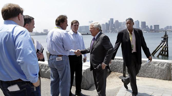 New England Patriots football team owner Robert Kraft, second from right, speaks with reporters during a break in the NFL spring meeting in Boston, Tuesday, May 21, 2013. (AP Photo/Elise Amendola)