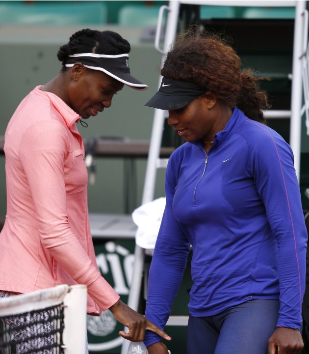 Williams of the U.S. and her sister Serena arrive to attend a training session for the French Open tennis tournament at the Roland Garros stadium in Paris