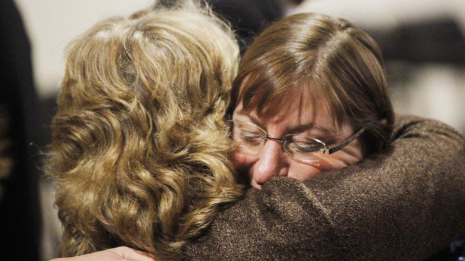 Jane Clementi hugs a family member following the verdict in the trial of Dharun Ravi, on Friday, March 16, 2012 at the Middlesex Superior Court in New Brunswick, N.J.  Ravi, a former Rutgers University student accused of using a webcam to spy on his gay roommate's love life has been convicted of bias intimidation and invasion of privacy. A jury found that he used a webcam to spy on roommate Tyler Clementi.  Within days, Clementi realized he had been watched and jumped to his death from New York's George Washington Bridge in September 2010.   (AP Photo/The Star-Ledger, Jerry McCrea, Pool)