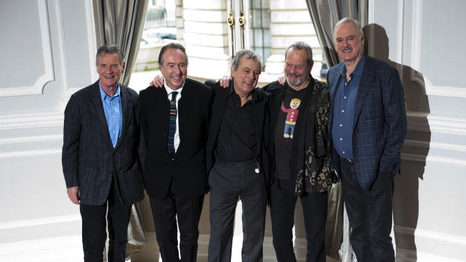 FILE - In this Thursday, Nov. 21, 2013, file photo the surviving members of the Monty Python comedy group, from left, Michael Palin, Eric Idle, Terry Jones, Terry Gilliam and John Cleese pose for photographers during a photocall to promote a reunion stage show they are going to perform together, at a hotel in London. American Monty Python fans who can't attend the troupe's London reunion can always look on the bright side of life. The show will be screened in hundreds of U.S. movie theaters. The anarchic British comedians are reuniting for 10 shows at London's O2 Arena in July, 34 years after their last stage performance. (AP Photo/Matt Dunham, File)