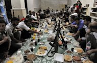 Syrian rebels break their fast with the &quot;iftar&quot; meal during the Muslim fasting month of Ramadan in the northern city of Aleppo. A commercial hub and home to 2.5 million people, Syria&#39;s second city Aleppo has become a new front in the country&#39;s 16-month uprising, after being largely excluded from the violence